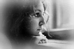 sad-woman-looking-out-dark-window2